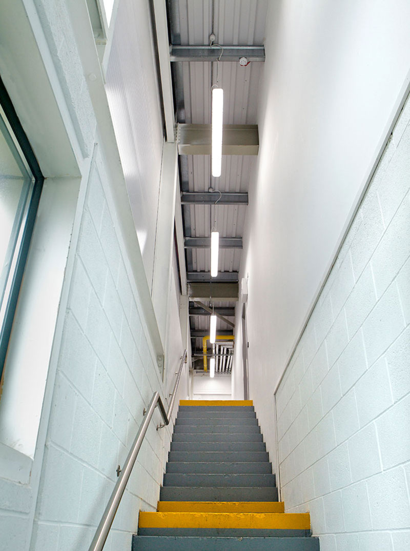 ROBUS VULCAN LED Corrosion Proof installed in the stairwell outside the store room and workshop of Takeda Ireland, Grange Castle